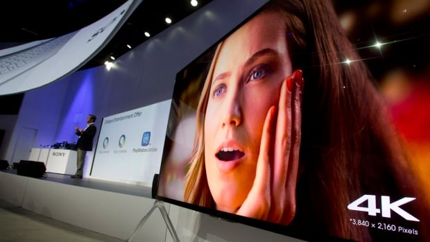 A Sony 85-inch Bravia XBR-X950B 4K television plays video at the 2014 Consumer Electronics Show in Las Vegas. 4K TVs have been around since 2013, but a drop in prices and an increase in available content is now pushing them into the mainstream.