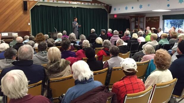 David Eby, NDP housing critic, talks to Victoria-area renters concerned about potential renovictions.