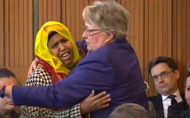 Woman comforted