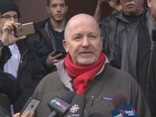 Gregory Alan Elliot speaks to reporters outside Old City Hall in Toronto after being found not guilty of harassing two women online, on Jan. 22, 2016.