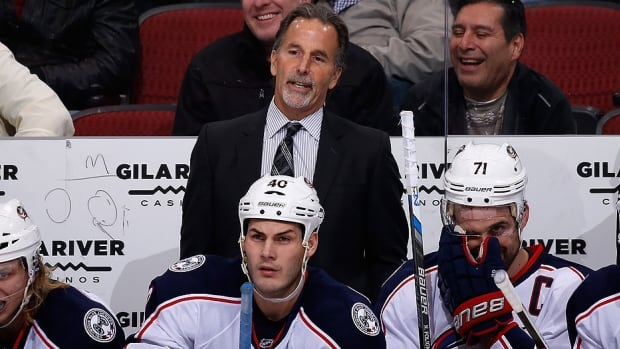 Blue Jackets head coach John Tortorella will not be behind the bench in Boston on Saturday night after he broke two ribs in a collision with Columbus forward Rene Bourque at Friday's outdoor practice. Bourque was part of a 3-on-3 drill, and Tortorella was along the left boards near centre ice when Bourque took a tumble and undercut his coach. Associate coach Craig Hartsburg will lead Columbus against the Bruins.