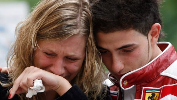 Students gather at a memorial for victims of the Dawson College shooting outside the downtown school in Montreal on Sept. 15, 2006.