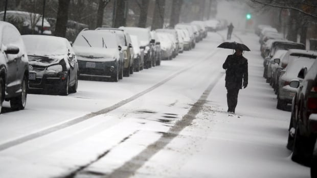 A man walks in the snow after a winter storm arrived in Washington Jan. 22, 2016.