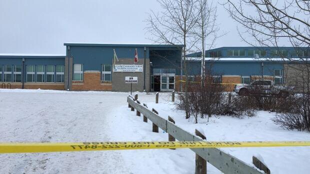 Police tape surrounds the La Loche Community School in La Loche, Sask. where two people were shot to death.