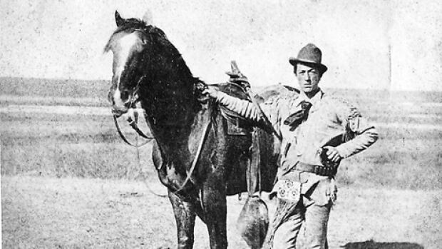 Constable James H. Schofield of the N.W.M.P. and his horse. Schofield was a dispatch rider between Fort Walsh (near Battle Creek, Sask.), Fort MacLeod, and Fort Calgary. Dispatch riders tied the idea of 'law and order' together in the early prairies through the messages they delivered.
