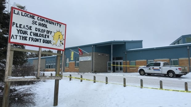 La Loche Community School was still covered in yellow police tape on Saturday.