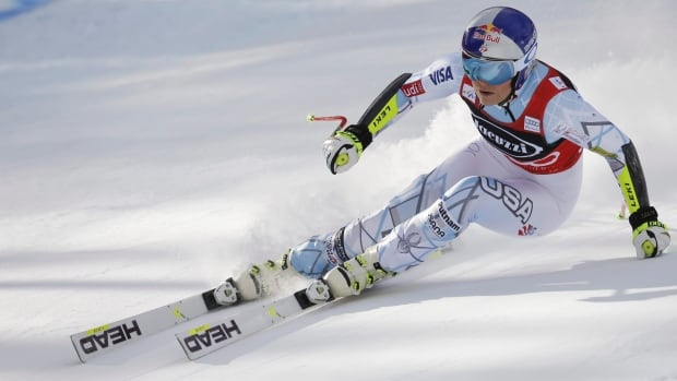 Lindsey Vonn speeds down the course on her way to win an alpine ski, women's World Cup super-G, in Cortina D'Ampezzo, Italy, on Sunday, Jan. 24, 2016.