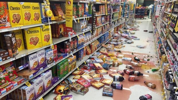 Boxes of cereal and bottles of juice lie on the floor of a Safeway grocery store following a magnitude 6.8 earthquake on the Kenai Peninsula in south-central Alaska on Sunday.