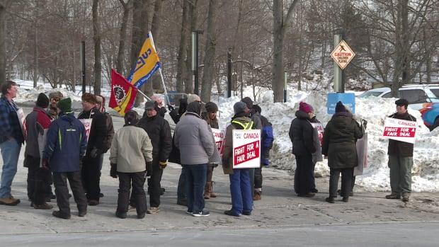 Members of the Halifax Typographical Union walk the picket line outside Chronicle Herald's Halifax offices on Saturday, the first day of their strike.