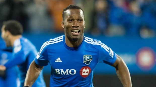 Montreal Impact's Didier Drogba celebrates after scoring against Toronto FC during first half MLS playoff soccer action in Montreal, Thursday, October 29, 2015