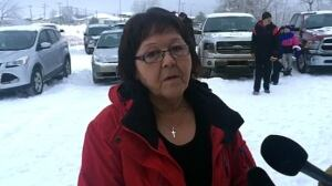 Albertine Janvier speaks outside at La Loche church