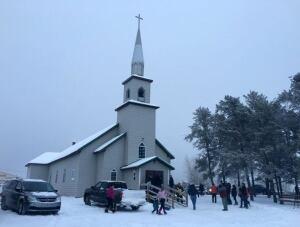 People file into church in La Loche, Sask.