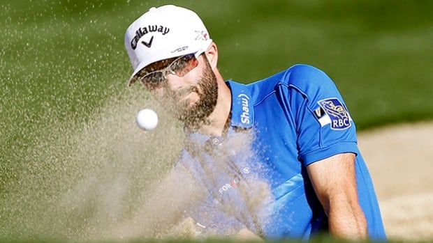 Adam Hadwin hits out of the bunker on the eighth fairway during the final round of the CareerBuilder Challenge golf tournament on the TPC Stadium course at PGA West in La Quinta, Calif., on Sunday.