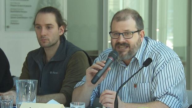 Yann Tremblay-Marcotte and Serge Peticlerc of the Coalition Objectif Dignité say cutting welfare cheques for some Quebecers could push them into poverty and crime.