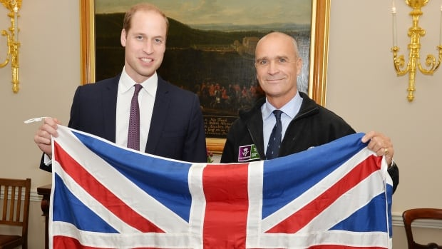 Prince William poses with a British flag with Henry Worsley (right) at Kensington Palace, in London on Oct. 19, 2015.  Worsley has died after attempting to cross the Antarctic solo.