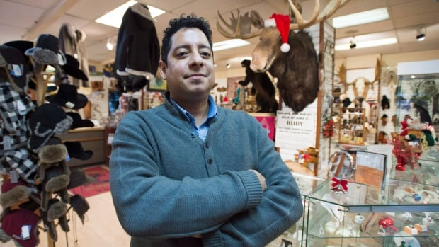 Souvenir shop owner Alexander Kiorpelidis hopes to see a rise in sales during the high season this summer.