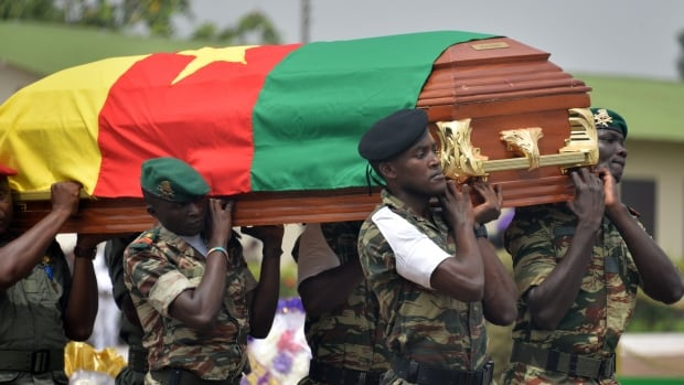 Cameroonian soldiers carry a coffin containing the remains of a fellow soldier during a ceremony for 38 troops who died in the north of the country in March 2015 while fighting Islamist Boko Haram militants. There was more violence reported Jan. 25, when four suicide bombers struck in the region.