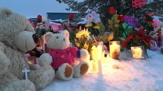 Memorial in front of La Loche Community School in La Loche, Sask. where one of the shootings took place.