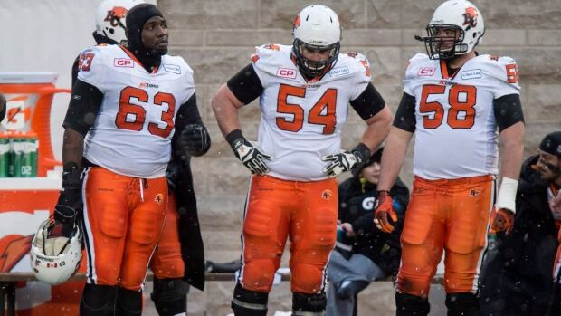 Offensive lineman Dean Valli, centre (No. 54), a British Columbia native, announced his retirement after 10 seasons and two Grey Cups with the B.C. Lions.