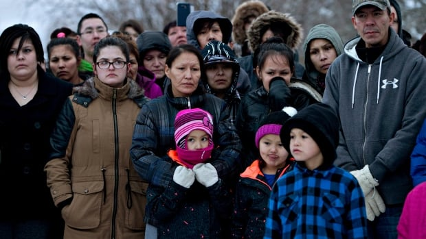 Members of the community come out to watch Saskatchewan Premier Brad Wall speak in La Loche, Sask., on Sunday, Jan. 24, 2016. A shooting Friday left four people dead.