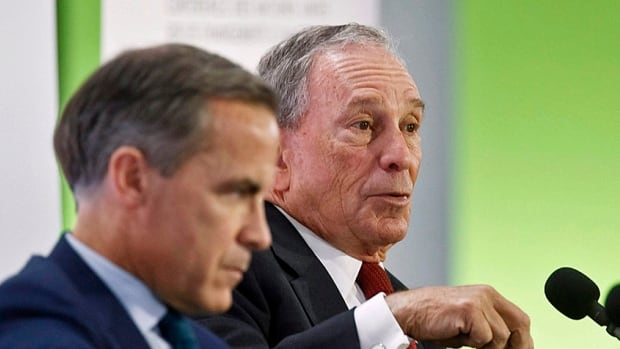 """Former New York City mayor Michael Bloomberg, right, speaks during a panel discussion on""""Climate Change and Financial Markets"""" alongside Bank of England governor Mark Carney at the UN climate conference in Paris in December."""