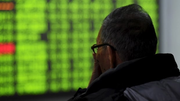 An investor looks at an electronic screen at a brokerage house in Hangzhou, Zhejiang province, on Tuesday. China stocks plunged 6.4 per cent on Tuesday after yet another late bout of panic selling.