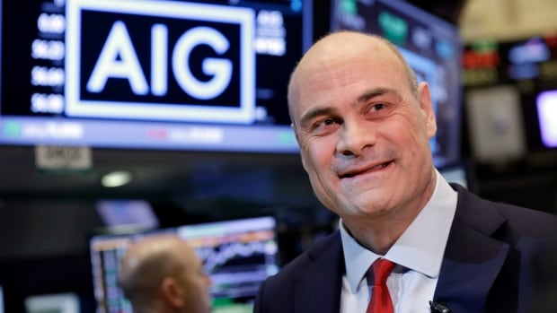 AIG President and CEO Peter Hancock is interviewed on the floor of the New York Stock Exchange on Tuesday after selling its broker-dealer segment to Canada's PSP Investments and Lightyear Capita.