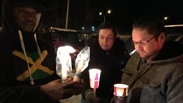Residents of Buffalo Narrows, Sask., held a roadside vigil Tuesday to pay their respects to La Loche shooting victim Marie Janvier.