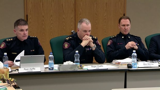 Calgary Police Chief Roger Chaffin, centre, says he is pleased with the reduction in the  number of police vehicles caught speeding.