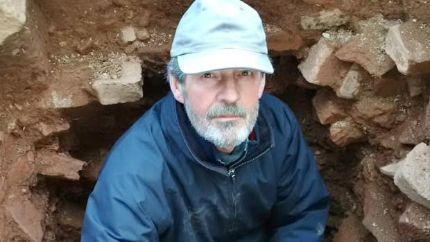 Parks Canada archaeologist Charles Burke excavating part of the cellar of home built by Colonel Joseph Morris at the Fort Lawrence National Historic Site along the Nova Scotia-New Brunswick border.
