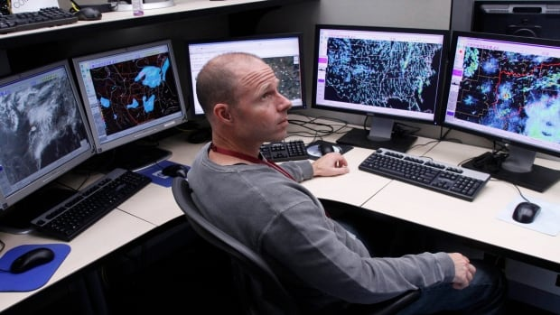 A meteorologist monitors weather models for a coming storm at the National Weather Service's Storm Prediction Center. From the weather, to sports stars, to the price of oil, humans are obsessed with predicting the future — even when the results are often very unreliable.