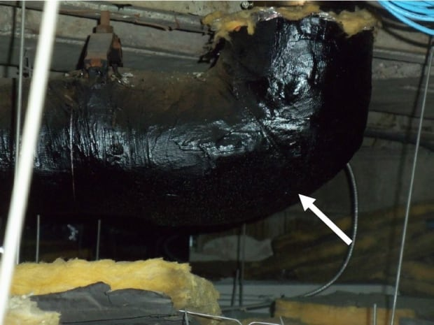 pipe inside government building asbestos 875 Heron Road Ottawa CRA
