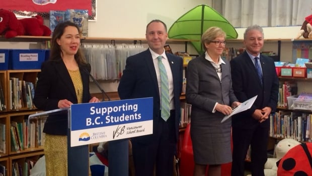 B.C. Education Minister Mike Bernier, centre, announces $11.6-million to seismically upgrade Sir Charles Kingsford-Smith Elementary School in South Vancouver.