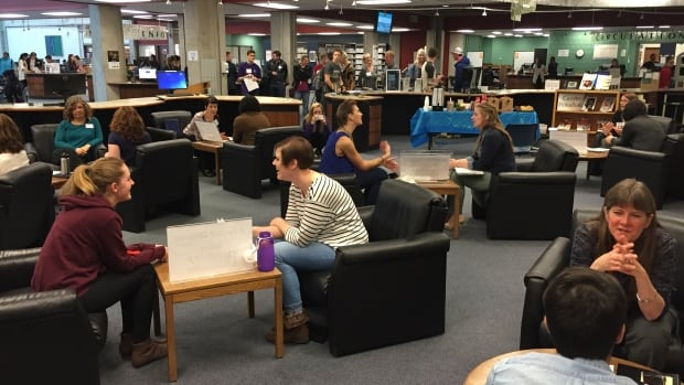 """Mount Royal University hosted a """"living library"""" event on January 27, 2016. Attendees could loan a """"human book"""" and listen to that person's personal story."""