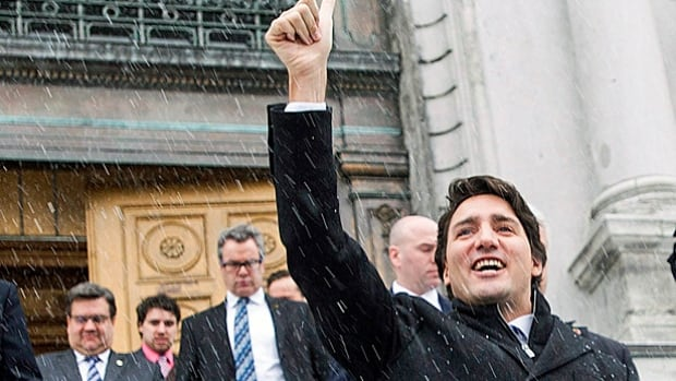No cheerleader for pipelines. Prime Minister Justin Trudeau gives a 'thumbs up' to protesters following his meeting with Montreal mayor and pipeline opponent Denis Coderre in Montreal, Tuesday.