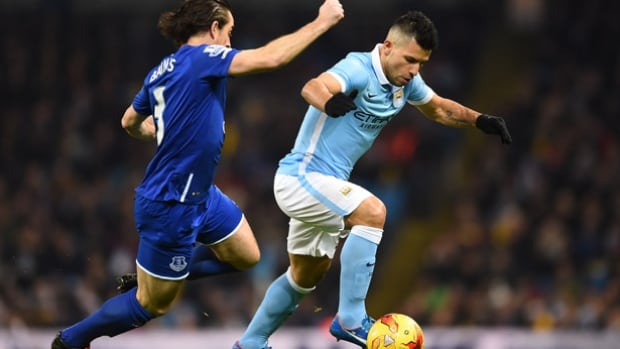 Manchester city's Sergio Aguero, right, defended by Leighton Barnes of Everton, scored the deciding goal in the second leg of the semifinal that sent his team to the English League Cup final.