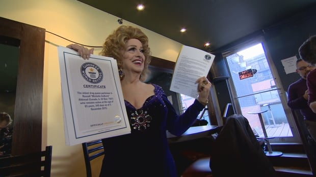 Toronto's Michelle DuBarry, also known as Russell Alldread, holds up certificate naming him the oldest performing drag queen by Guinness World Records.