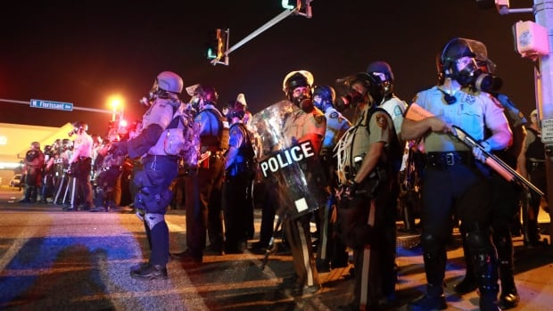 Police from various departments stand guard on Aug. 18, 2014, in Ferguson, Mo., just days after the shooting of teenager Michael Brown sparked sometimes violent protests.