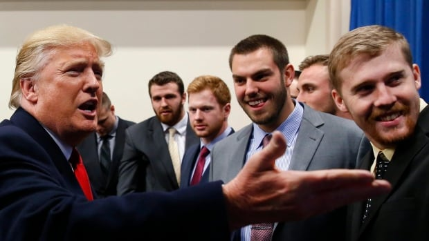 Republican presidential candidate Donald Trump speaks with University of Iowa football players before a campaign event in Iowa City. Even if Trump's campaign takes a hit in the Iowa caucuses, his supporters and the disgruntlement with the party establishment they represent won't be going away.