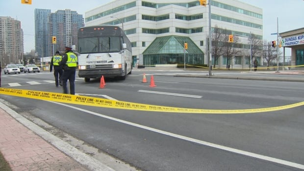 Toronto police on the scene near Kipling Avenue and Dundas Street where a woman was struck by a bus.
