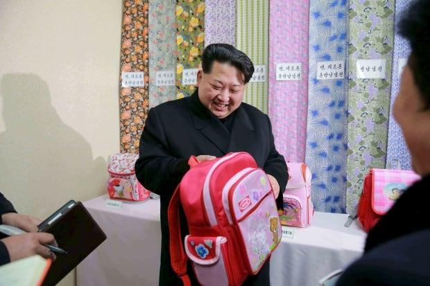 WIP NORTH KOREA-Kim Jong Un looks at back packs Jan 28 2016