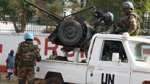 UN peacekeepers take a break as they patrol along a street during the presidential election in Bangui, the capital of Central African Republic on Dec. 30, 2015.