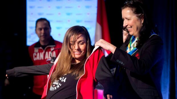 """Tricia Smith, shown at right in this 2014 file photo, is the new president of the Canadian Olympic Committee. Former Canadian Olympian Jenn Heil says Smith has the """"opportunity to transform the organization into a world class institution, in terms of governance, transparency, and accountability. """""""