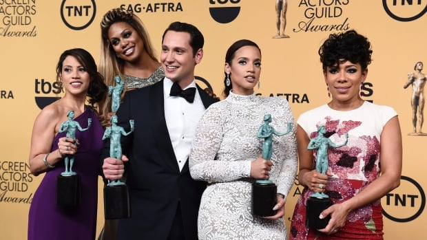 Orange is the New Black cast members, from left, Elizabeth Rodriguez, Laverne Cox, Matt McGorry, Dascha Polanco and Selenis Leyva pose with the 2015 SAG award for outstanding ensemble in a comedy series in Los Angeles. The 2016 edition of the gala takes place Saturday.