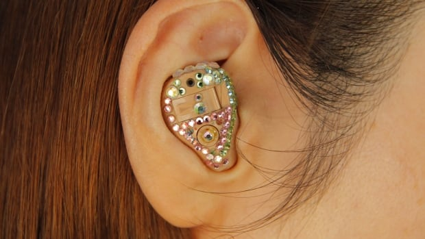 Why are glasses cool, but not hearing aids like this one, decorated with crystals?