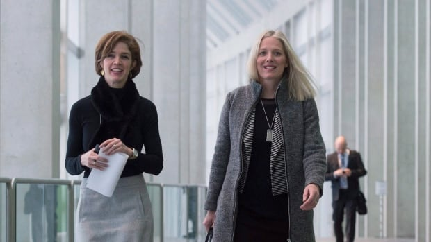 Minister of Environment and Climate Change Catherine McKenna, right, and adviser Jane McDonald walk to a meeting with provincial environment ministers on  Friday in Ottawa.