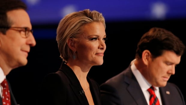Fox News anchor Megyn Kelly sits between fellow debate moderators Chris Wallace, left, and Bret Baier during the debate held by Fox News for the top 2016 U.S. Republican presidential candidates in Des Moines, Iowa, on Thursday night.