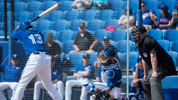 Maicer Izturis (13) bats during first inning baseball intrasquad spring training action in Dunedin, Fla., on Monday, March 2, 2015.