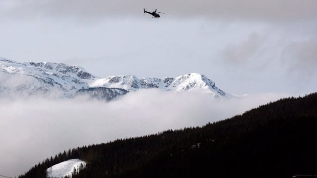 "A search and rescue helicopter heads toward the area where a large avalanche struck near Revelstoke, B.C., in this Sunday, March 14, 2010 file photo. Five snowmobilers have died in a ""very large'' avalanche near the interior community of McBride, B.C., on Friday, prompting a rescue and recovery operation."
