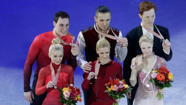 Gold medallists Tatiana Volosozhar and Maxim Trankov, centre, of Russia, silver medallists Aliona Savchenko and Bruno Massot, left, of Germany, and bronze medallists Evgenia Tarasova and Vladimir Morozov, right, of Russia pose for a photo after their Pairs' Free Program at the European figure skating championships in Bratislava, Slovakia, on Saturday, Jan. 30, 2016.
